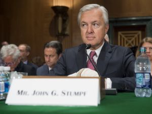 John Stumpf, chairman and CEO of Wells Fargo, arrives to testify about the unauthorized opening of accounts by Wells Fargo during a Senate Banking, Housing and Urban Affairs Committee hearing on Capitol Hill in Washington, DC, September 20, 2016.