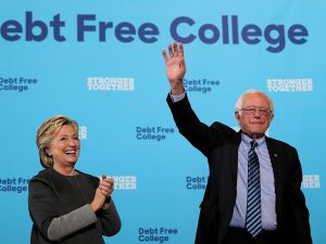 Democratic presidential nominee former Secretary of State Hillary Clinton (L) and U.S. Sen. Bernie Sanders (I-VT) greet supporters during a campaign rally at University of New Hampshire on September 28, 2016 in Durham, New Hampshire. Hillary Clinton is campaigning in New Hampshire.