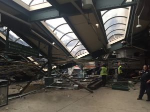 A NJ Transit train seen through the wreckage after it crashed in to the platform at the Hoboken Terminal September 29, 2016 in Hoboken, New Jersey.