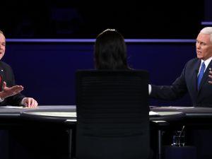 Sen. Tim Kaine and Gov. Mike Pence flank Elaine Quijado.