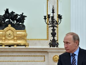 Russian President Vladimir Putin meets with Prince Albert II of Monaco (not pictured) at the Kremlin in Moscow on October 6, 2016. / AFP / POOL AND AFP / YURI KADOBNOV