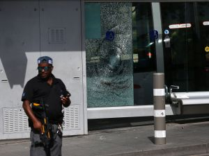 An Israeli security forces member stands guard at the site of a shooting attack near the Israeli police headquarters in mainly Palestinian east Jerusalem on October 9, 2016. A shooting attack in Jerusalem left at least three people wounded, including two seriously, with the assailant killed by police, Israeli authorities said.