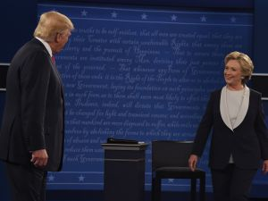 Republican nominee Donald Trump and Democratic nominee Hillary Clinton arrive on the stage before they participate in the 2nd debate at Washington University in St. Louis