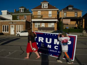 Two supporters of Republican candidate for President Donald J Trump leave after a rally where the candidate some to a crowd of 3000 at Ambridge Area Senior High School on October 10, 2016 in Ambridge, Pennsylvania. Ambridge, Pennsylvania, named after the American Bridge Company, a steel fabricating plant that employed 60,000 workers is a traditionally Democratic stronghold, but is shifting Republican as a shrinking tax base and lost jobs having devastating economic effects on the former industrial community.