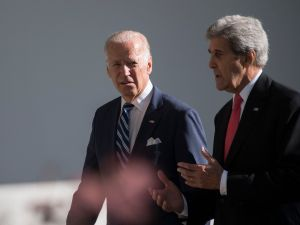 US Vice President Joe Biden (L) speaks with US Secretary of State John Kerry as they walk the colonnade at the White House in Washington, DC, October 18, 2016.