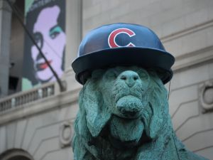 CHICAGO, IL - OCTOBER 24: A lion sculpture outside the Art Institute of Chicago wears a batting helmet to help the city celebrate the Chicago Cubs making it into the World Series on October 24, 2016 in Chicago, Illinois. The Cubs will face off against the Cleveland Indians in the World Series beginning tomorrow. This will be the Cubs first trip to the Series since 1945. The Indians last trip to the Series was 1948.