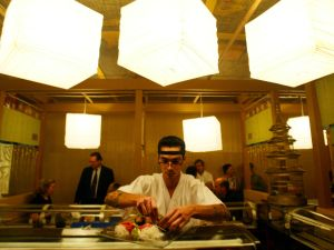 400034 01: Sushi chef Joe Bracero prepares a plate January 23, 2002 at the debut of the Sushi Doraku restaurant in South Beach, Florida. The new sushi concept restaurant created by the Benihana corp. offers customers sushi, sake and music.