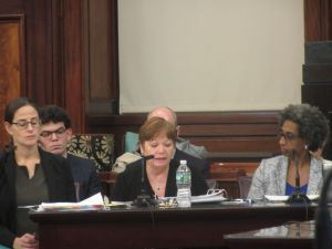 ACS Commissioner Gladys Carrion, center, cries during a City Council hearing on child abuse cases.