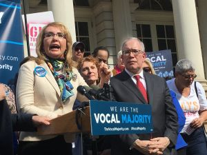 Former Congresswoman Gabrielle Giffords discusses gun violence prevention near City Hall steps.