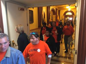 Laborers file out of Senate Chambers in Trenton after a vote to put them back to work by funding the Transportation Trust Fund is delayed.