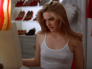 Cher Horowitz perusing her closet options.