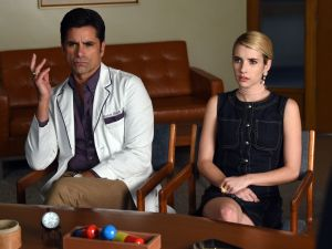John Stamos and Emma Roberts in Scream Queens.