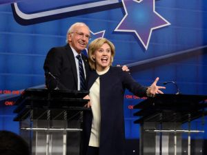 Larry David and Kate McKinnon as Bernie Sanders and Hillary Clinton.