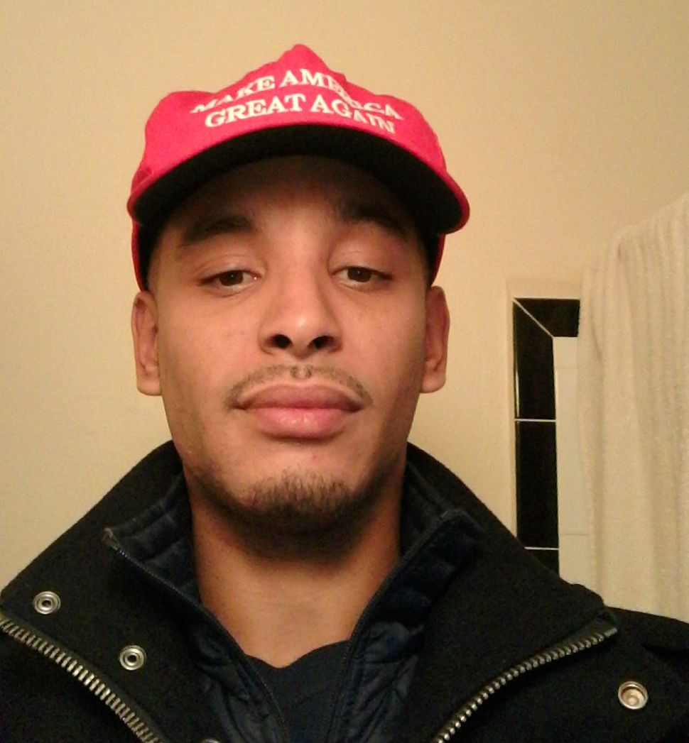EXCLUSIVE: Trump Supporter Attacked at NYC College; MAGA Hat Almost Set Alight