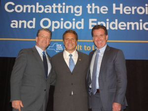 Senate Majority Leader John Flanagan, right, with Gov. Andrew Cuomo, center, and State Senator Terence Murphy.