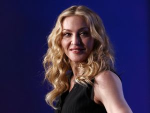 INDIANAPOLIS, IN - FEBRUARY 02: Singer Madonna looks on on during a press conference for the Bridgestone Super Bowl XLVI halftime show at the Super Bowl XLVI Media Center in the J.W. Marriott Indianapolis on February 2, 2012 in Indianapolis, Indiana.