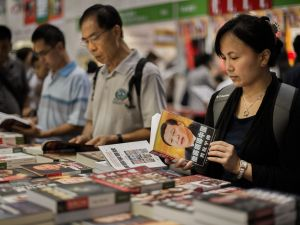 Visitors browse Chinese political books at the Hong Kong Book Fair in Hong Kong on July 18, 2012.