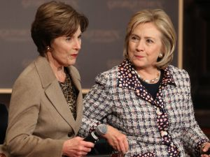 Former Secretary of State Hillary Clinton (R) and former first lady Laura Bush participate in an event to advance the women of Afghanistan in 2013.