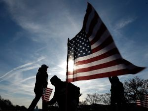 U.S. military veterans set up 1,892 American flags on the National Mall March 27, 2014 in Washington, DC.