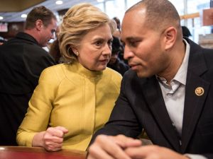 Hillary Clinton confers with Congressman Hakeem Jeffries at Junior's Restaurant in Brooklyn before the April Democratic primary.
