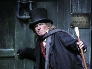 "Actor Tommy Steele poses at a photocall to promote his role as Ebenezer Scrooge in the new stage version of ""Scrooge"" at the London Palladium on October 27, 2005 in London, England."