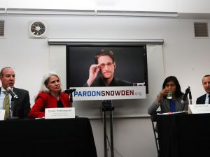 Edward Snowden speaks via video link at a news conference for the launch of a campaign calling for President Obama to pardon him on September 14, 2016 in New York City.
