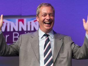 Outgoing UKIP leader Nigel Farage prepares to congratulate MEP Diane James after she was announced as the new leader of UKIP at the Bournemouth B.I.C where the United Kingdom Independent Party are holding their annual conference on September 16, 2016 in Bournemouth, England.