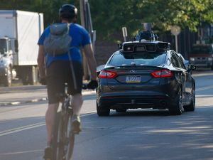 PITTSBURGH, PA - SEPTEMBER 22: An Uber driverless Ford Fusion drives down Smallman Street on September, 22, 2016 in Pittsburgh, Pennsylvania. Uber has built its Uber Technical Center in Pittsburgh and is developing an autonomous vehicle that it hopes will be able to transport its millions of clients without the need for a driver. (Photo by Jeff Swensen/Getty Images)