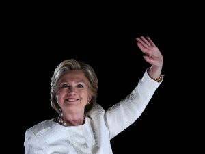 US Democratic presidential nominee Hillary Clinton waves to supporters during a campaign rally in Sanford, Florida, on November 1, 2016. With one week to go until election day, Hillary Clinton and Donald Trump were barnstorming battleground states, as the Democratic nominee tried to pivot away from attacks on her protection of US secrets. / AFP / JEWEL SAMAD