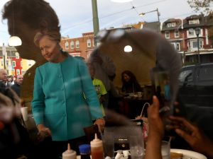 Democratic presidential nominee former Secretary of State Hillary Clinton greets patrons at Cedar Park Cafe on November 6, 2016 in Philadelphia, Pennsylvania. With two days to go until election day, Hillary Clinton is campaigning in Florida and Pennsylvania.