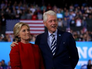 RALEIGH, NC - NOVEMBER 08: Democratic presidential nominee former Secretary of State Hillary Clinton (L) and her husband former U.S. President Bill Clinton look on during a campaign rally at North Carolina State University on November 8, 2016 in Raleigh, North Carolina. The midnight rally followed Clinton campaigning in Pennsylvania, Michigan and North Carolina in the lead up to today's general election.