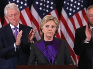 Former Secretary of State Hillary Clinton, accompanied by her husband former President Bill Clinton (L) and running mate Tim Kaine, concedes the presidential election at the New Yorker Hotel on November 9, 2016 in New York City.