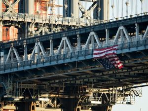 NEW YORK, NY - NOVEMBER 14: Hung by anti-Donald Trump protestors, an upside down American flag hangs from the side of the Manhattan Bridge.