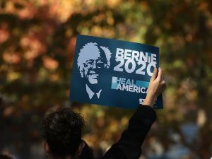 "WASHINGTON, DC - NOVEMBER 17: A protester holds up a sign as he listens to Bernie Sanders, (I-VT), speak at a rally, on Capitol Hill, November 17, 2016 in Washington, DC. The National Nurses United, and Progressive Democrats of America held rally to demand ""economic and social justice and equality."""