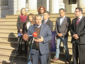 Bronx Assemblyman Marcos Crespo speaks in front of the City Hall steps.