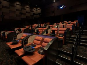 iPic offers pod-like seating and in-movie service.