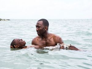 Alex Hibbert and Mahershala Ali in Moonlight.