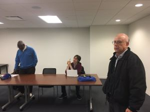 Assemblyman Keith Wright, head of the Manhattan Democratic Party, left, and outgoing Manhattan Board of Elections Commissioner Alan Schulkin, right, at the party's emergency meeting Sunday.