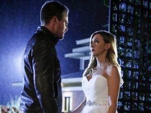 Stephen Amell as Oliver Queen and Katie Cassidy as Laurel Lance.