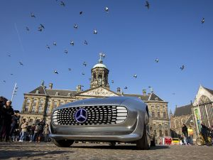 The Mercedes Benz F 015 self-driving stands on March 13, 2016 at the Dam square in Amsterdam. This model is presented for the first time in Europe. / AFP / ANP / Bart Maat / Netherlands OUT (Photo credit should read BART MAAT/AFP/Getty Images)