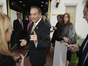 Congressman Chris Collins speaks to reporters.