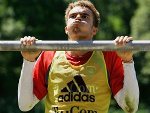 ROTTACH-EGERN, GERMANY - JULY 04: Valerien Ismael performs chin-ups during the Bayern Munich training session for the Bundesliga 2005/2006 Season on July 4, 2005 in Rottach Egern near Munich, Germany.