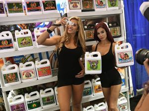 Models promote fertilisers used in the growth of marijuana plants at the Cannabis World Congress in Los Angeles, California on September 9, 2016. The three day event provides education, resources and tools for those involved in the fast growing cannabis industry in the United States.