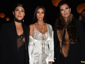 PARIS, FRANCE - OCTOBER 02: (L-R) Kourtney Kardashian, Kim Kardashian and Kris Jenner attend the Givenchy show as part of the Paris Fashion Week Womenswear Spring/Summer 2017 on October 2, 2016 in Paris, France.