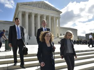 Alexandra Shapiro and John Cline, lawyers for Bassam Salman are seen outside of the US Supreme Court after attending a hearing in his insider trading case on October 5, 2016 in Washington, DC.