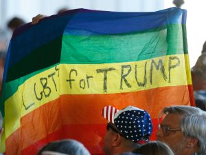 Supporters hold up a gay pride flag for Republican presidential candidate Donald Trump on October 18, 2016 in Grand Junction Colorado.