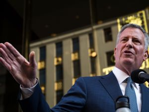 Mayor Bill de Blasio speaks to the press in front of Trump Tower after his meeting with then President-elect Donald Trump.