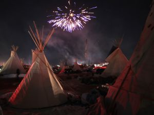 Fireworks fill the night sky above the Oceti Sakowin Camp as Native Americans and other protestors celebrate.