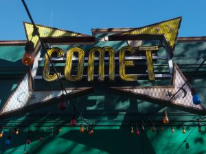The sign for the Comet Ping Pong restaurant is seen in Washingon, DC, on December 5, 2016. An assault rifle-wielding gunman's appearance at a Washington pizzeria that was falsely reported to house a pedophile ring has elevated worries over the unrelenting rise of fake news and malicious gossip on the internet. No one was injured when 28-year-old Edgar Maddison Welch strode into the Comet Ping Pong restaurant, packed with families on a Sunday afternoon, and fired off a round from his AR-15.