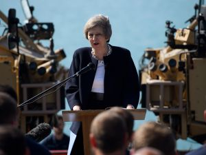 British Prime Minister Theresa May addresses sailors on board HMS Ocean during her trip to attend the Gulf Cooperation Council summit in Bahrain, on December 6, 2016 in Manama, Bahrain.